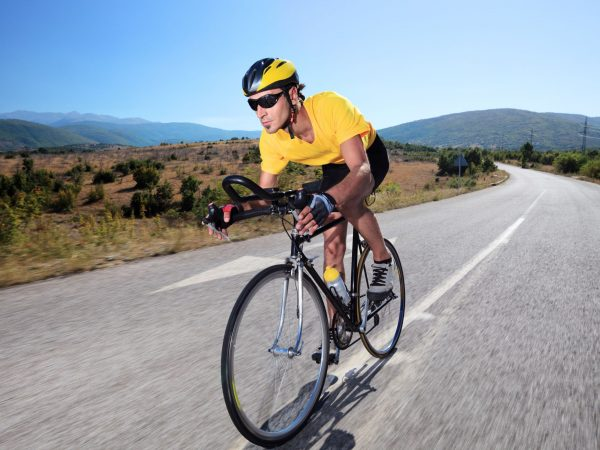 7776168 – cyclist riding a bike on an open road