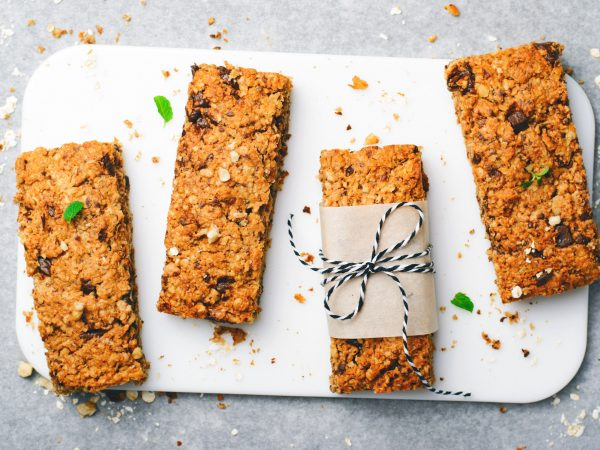 Granola Bars with Nuts and Chocolate Chips, Healthy Homemade Snack on Grey Background