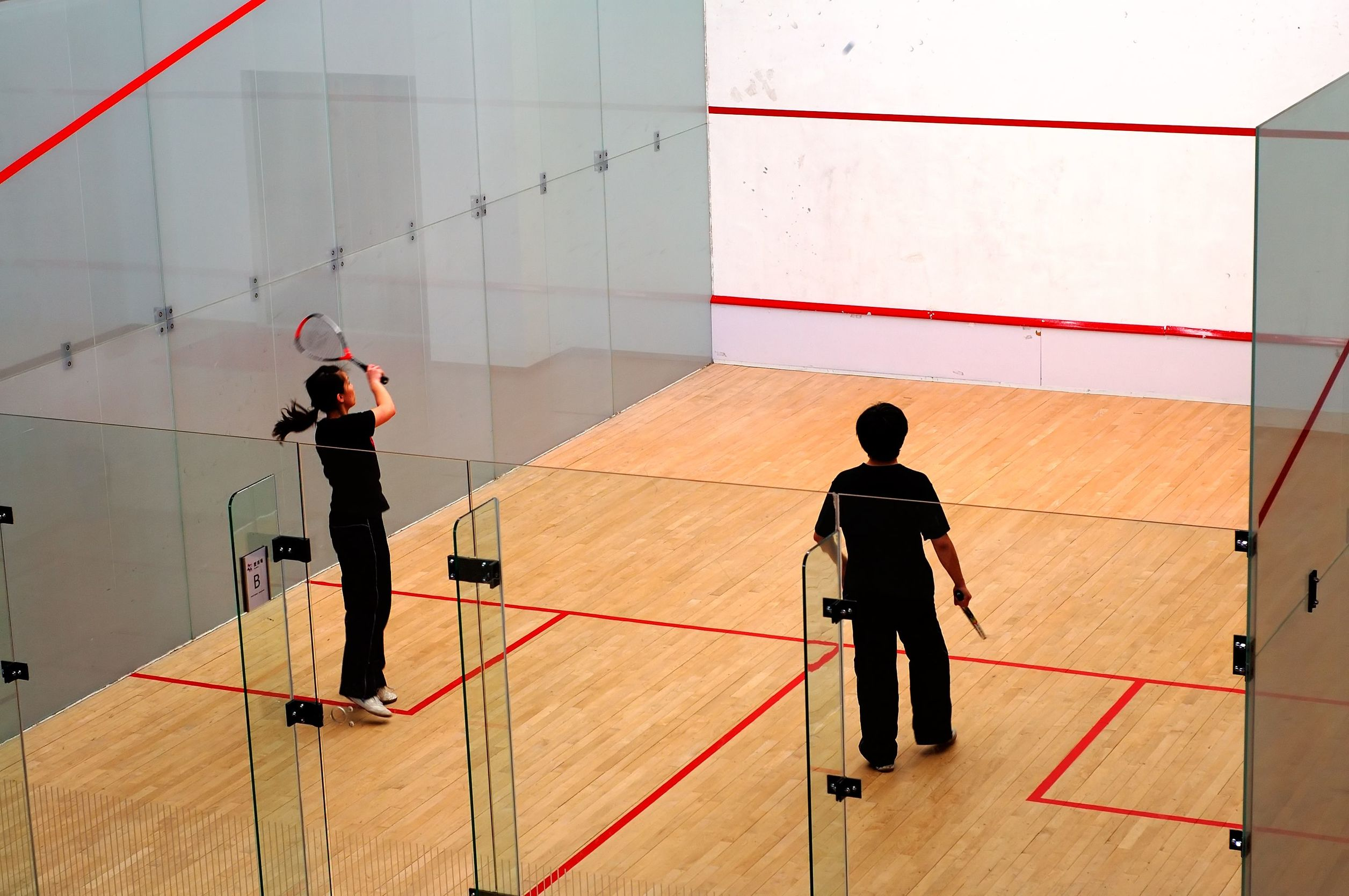 jugando squash